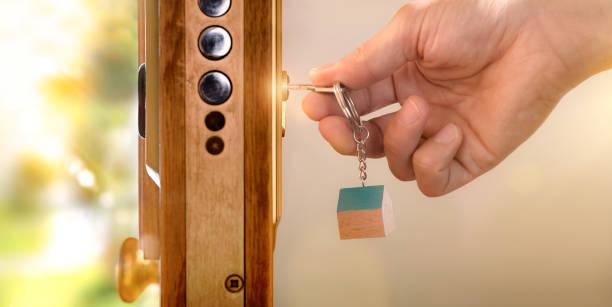 Door section with hands closing a door stock photo