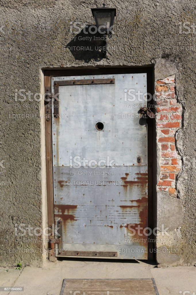 Door to a gas chamber and crematorium at nazi concentration camp. stock photo