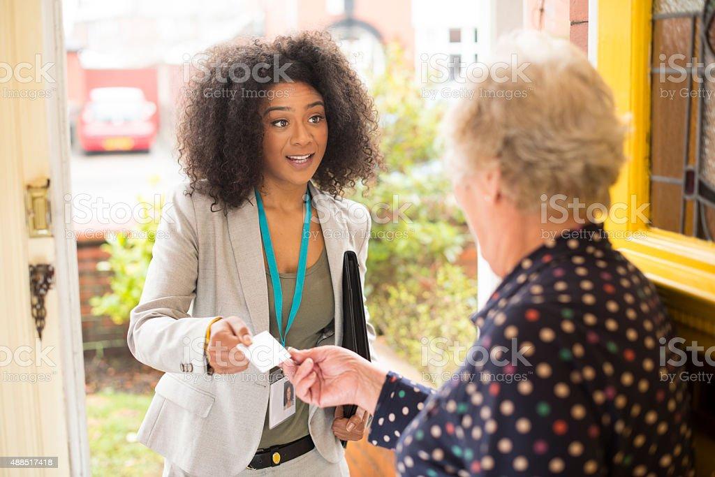 door to door saleswoman stock photo