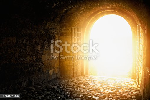 Door to Heaven. Arched passage open to heaven`s sky. Light at end of the tunnel. Hope metaphor.