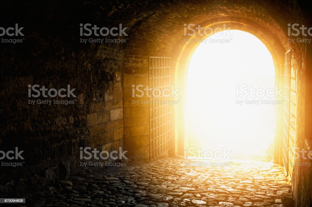 Door to Heaven. Arched passage open to heaven`s sky. Light at end of the tunnel. stock photo