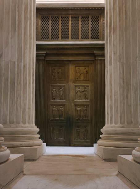 Door to Justice The front door of the United States Supreme Court House taken at night. ruth bader ginsberg stock pictures, royalty-free photos & images