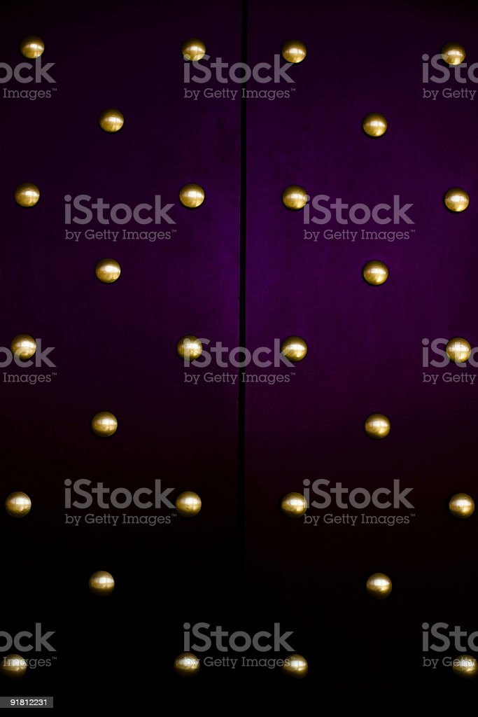 Door to the Buddhists temple with golden buttons stock photo