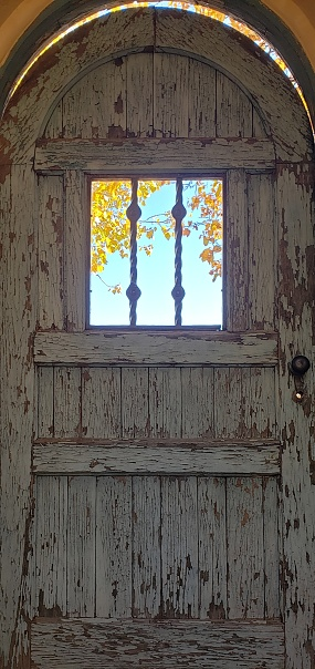 Photograph: Rustic door at the La Posada Hotel in Winslow, Arizona.