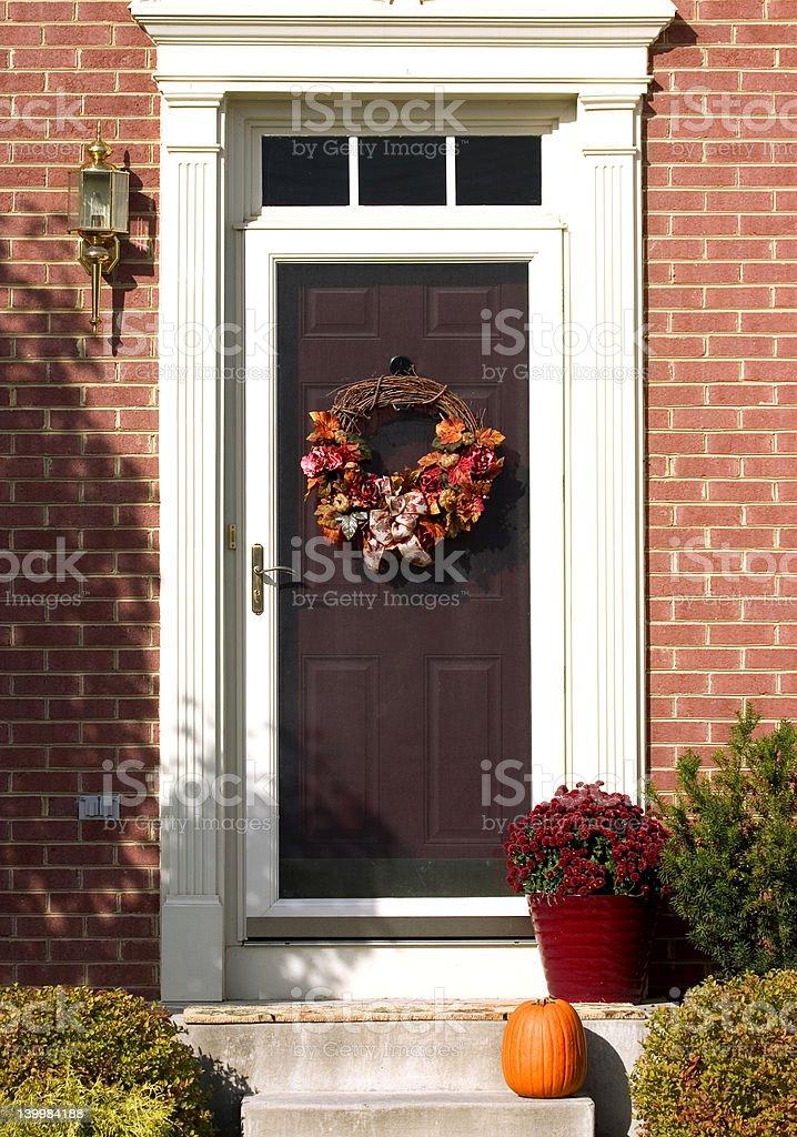 door with autumn wreath stock photo