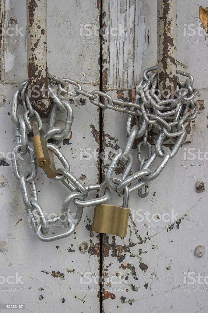 Door with chain and padlock 2 stock photo