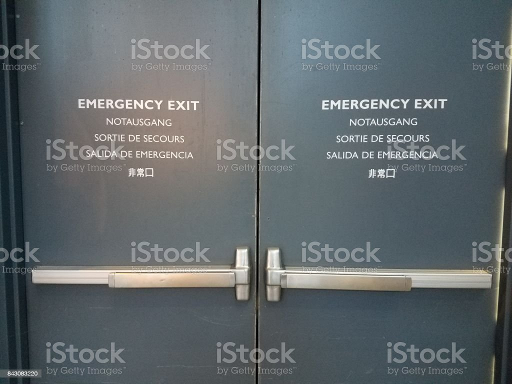 door with emergency exit sign stock photo