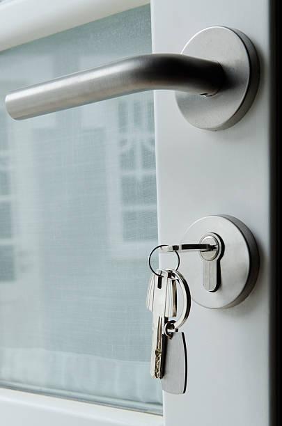 Door with keys in lock stock photo
