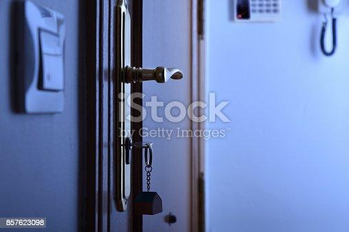 istock Door with keys in the lock security night concept 857623098