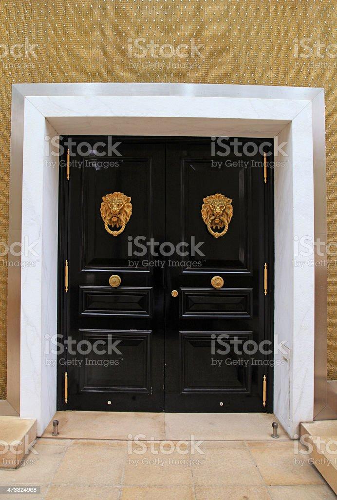 door with knob in the shape of brass lion, Monaco stock photo