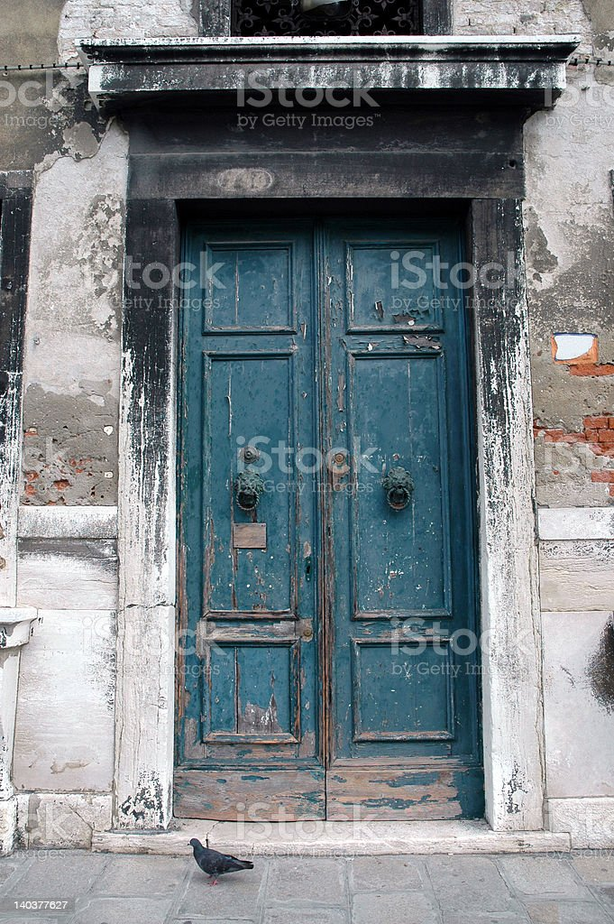 Door with peeling paint in Murano, Italy stock photo