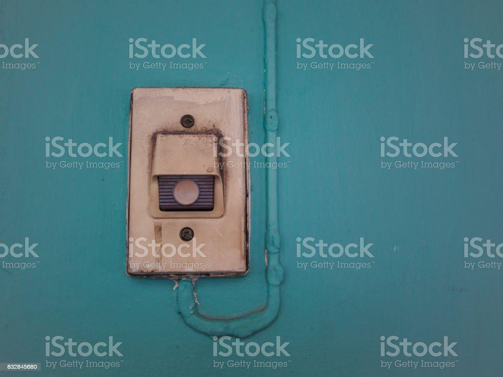 Doorbell on blue wall stock photo