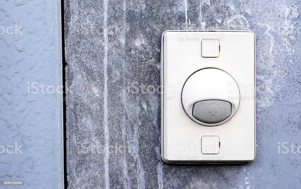 Doorbell ring button on the wall stock photo