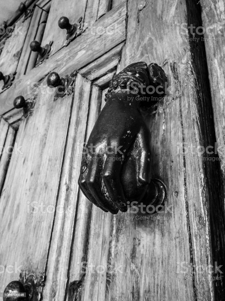 Door knob in the shape of a female hand, entrance door of the Church...