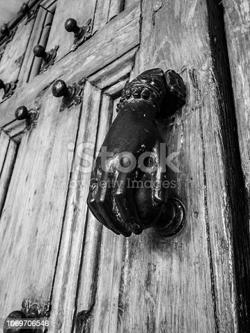 Door knob in the shape of a female hand, entrance door of the Church of the Abbey of Notre-Dame de Saint-Remy, Rochefort, Belgium, black and white photography