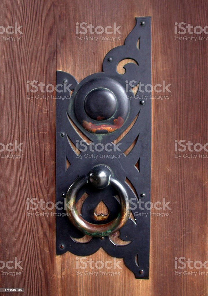 doorknob on a wooden panel door royalty-free stock photo