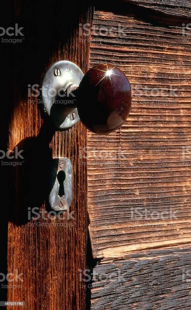 Doorknob on old wooden door Bodie Ghost Town California Scan stock photo