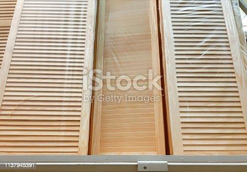 Doors blinds. Oak wood door with horizontal vent. Old Style Door .