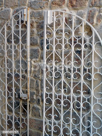 Open wicket of protective metal grilles from two opposite doors on the same wall
