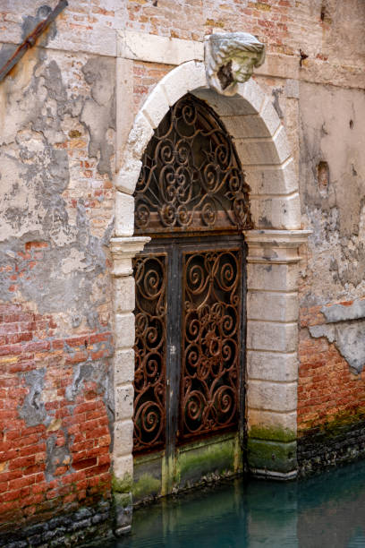 Doorway along a Venice canal stock photo