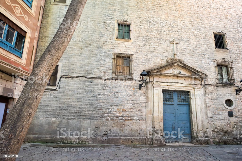 Doorway in the plaza Saint Felip Neri in Barcelona stock photo
