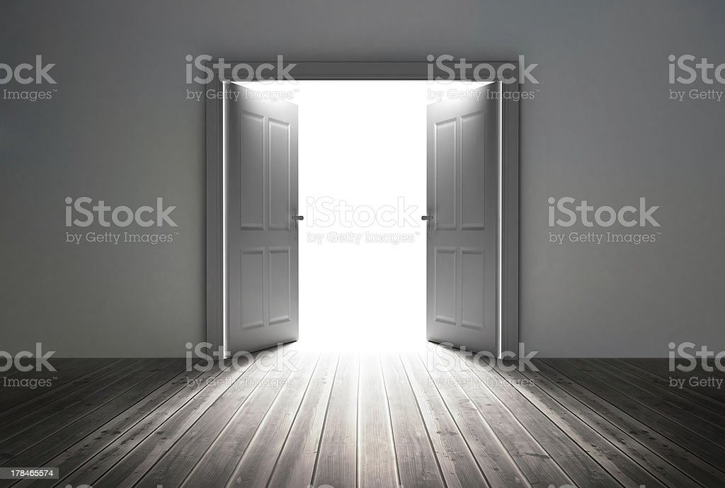 Doorway revealing bright light stock photo