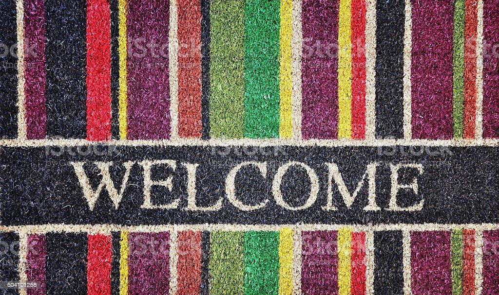Doorway rug or doormat, welcome, natural fibres, background stock photo