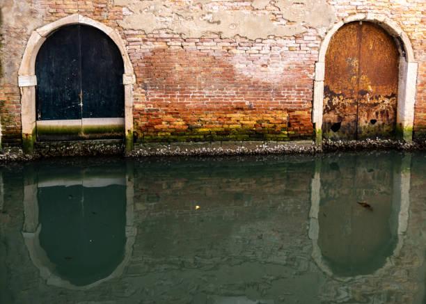 Doorways along a Venice canal stock photo