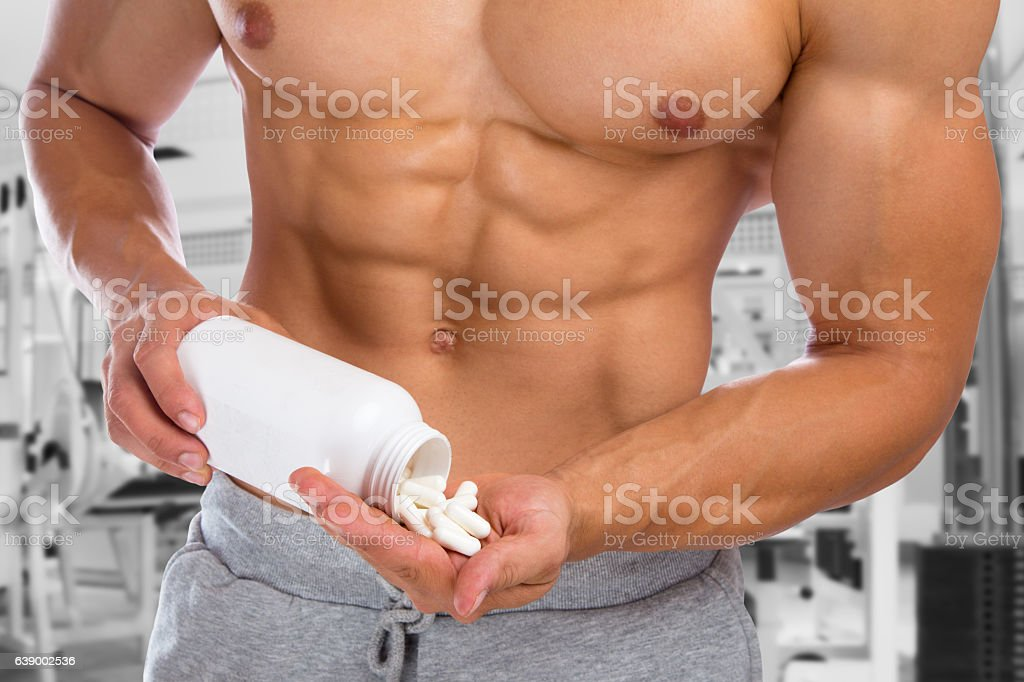 Doping anabolic pills abuse bodybuilder bodybuilding gym muscles stock photo