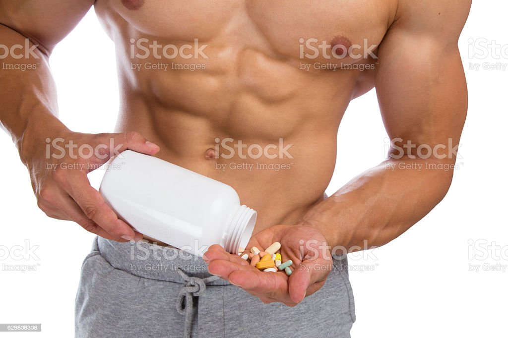 Doping anabolic pills bodybuilder bodybuilding muscles strong muscular stock photo