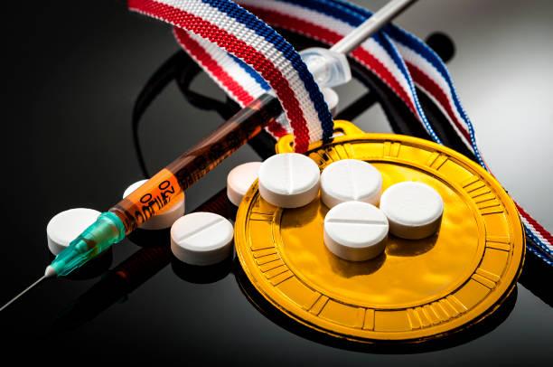 doping in sports and steroid abuse concept - esteróides imagens e fotografias de stock