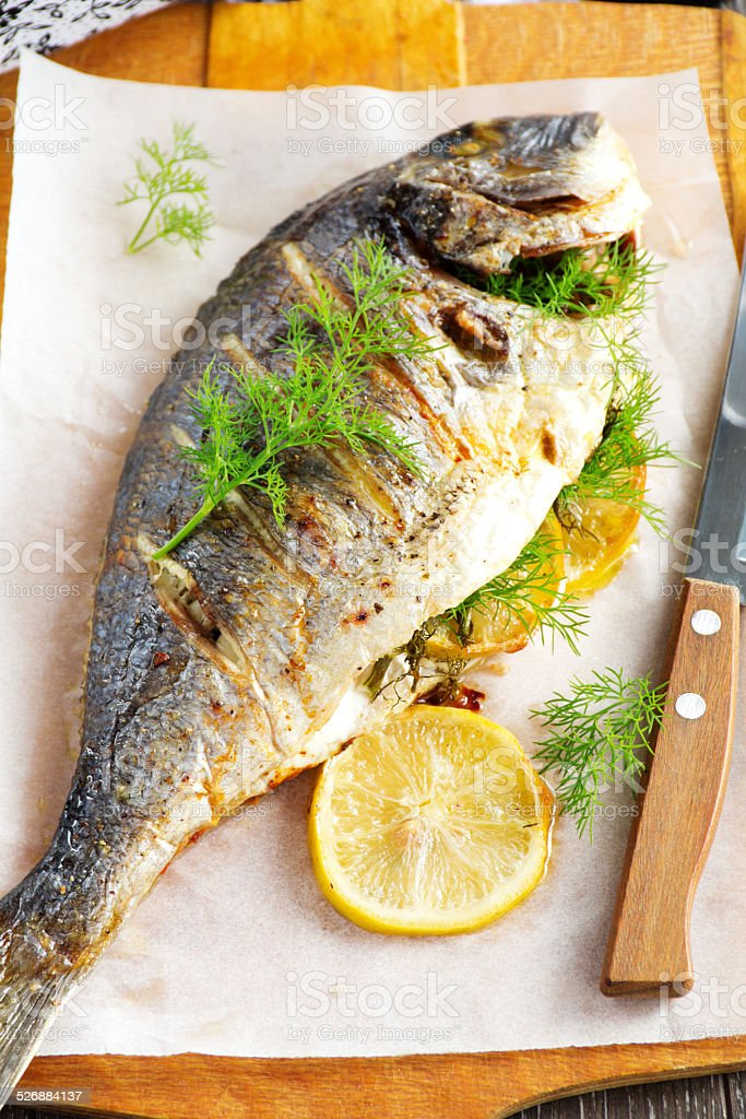 Dorado baked with lemon and fennel. stock photo