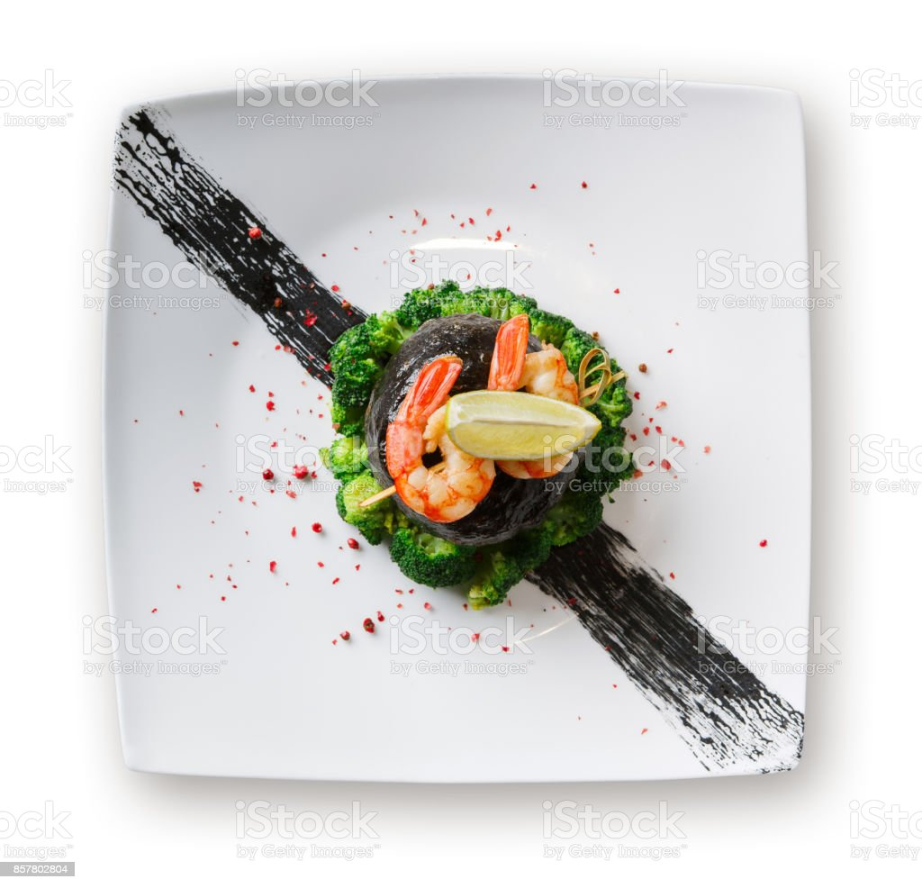 Dorado fillet in nori with shrimps isolated stock photo