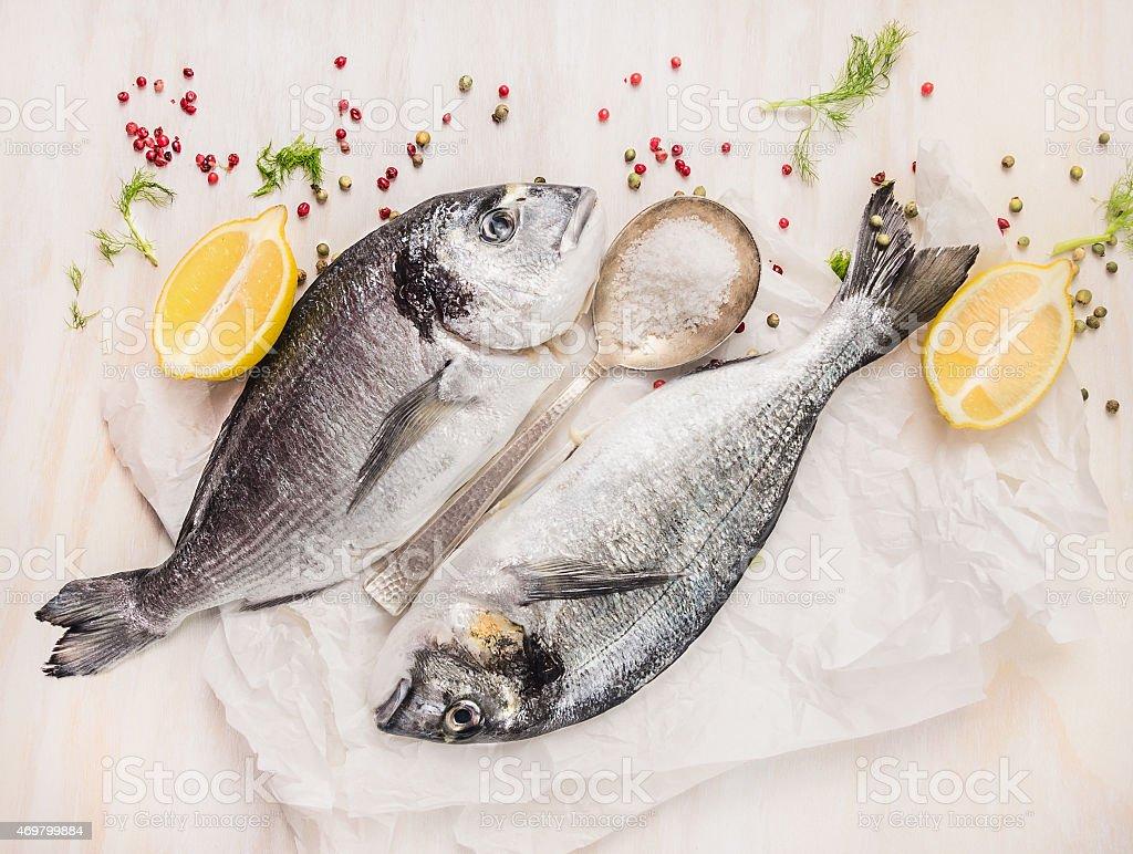 Dorado fish composing with lemon, spices and salt, top view stock photo