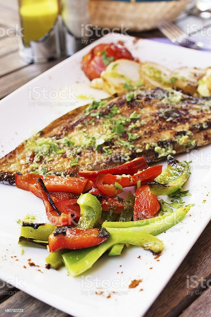 Dorado fish fillet with vegetables stock photo
