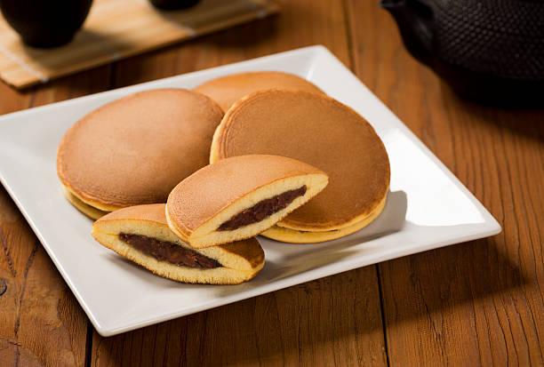 Dorayaki or Japanese Sweet Bean Pancakes with Tea stock photo