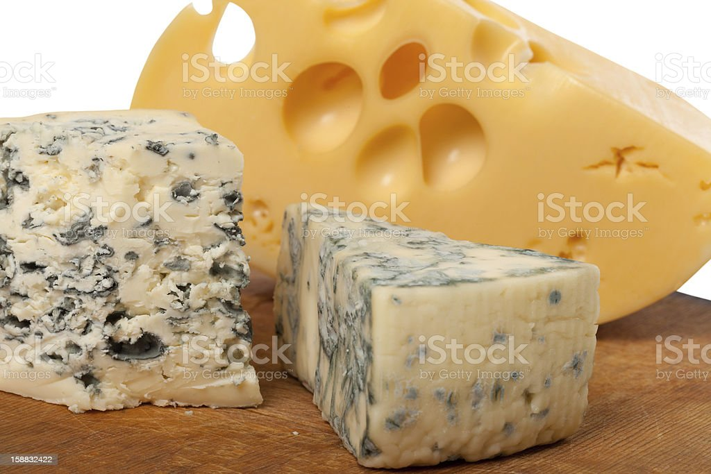 Dorblu and other cheeses on wooden board royalty-free stock photo