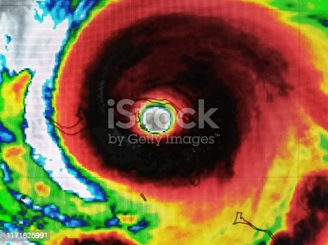 Enhanced Infrared satellite imagery of hurricane Dorian as a category 5 storm with 185 mph winds as it rages through the northern Bahama islands.