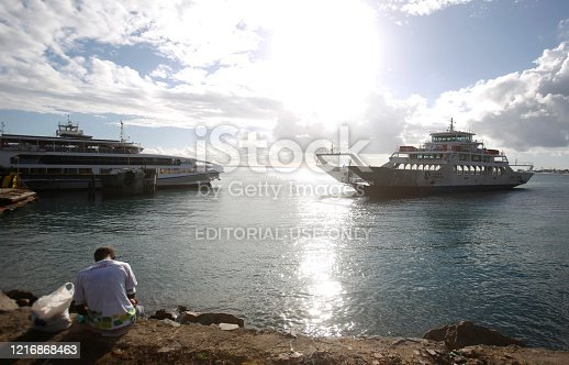salvador, bahia / brazil -  may 9, 2018: Dorival Caymmi ferry boat during approach at Sao Joaquim terminal in Salvador. the boat makes the crossing by the Bay of All Saints.