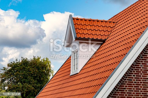 istock Dormer and newly covered gable roof 1028737338
