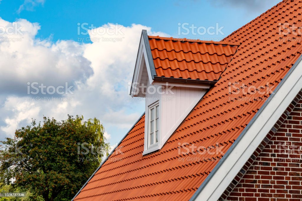 Dormer and newly covered gable roof stock photo