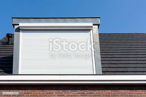 istock Dormer window with rolling safety  shutter 609689250