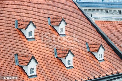Roof tiles and dormer windows.