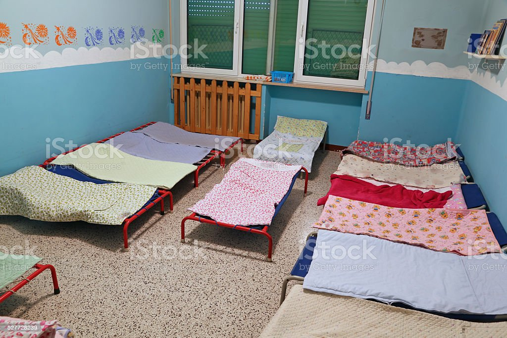 dormitory with beds for children in the early childhood school stock photo