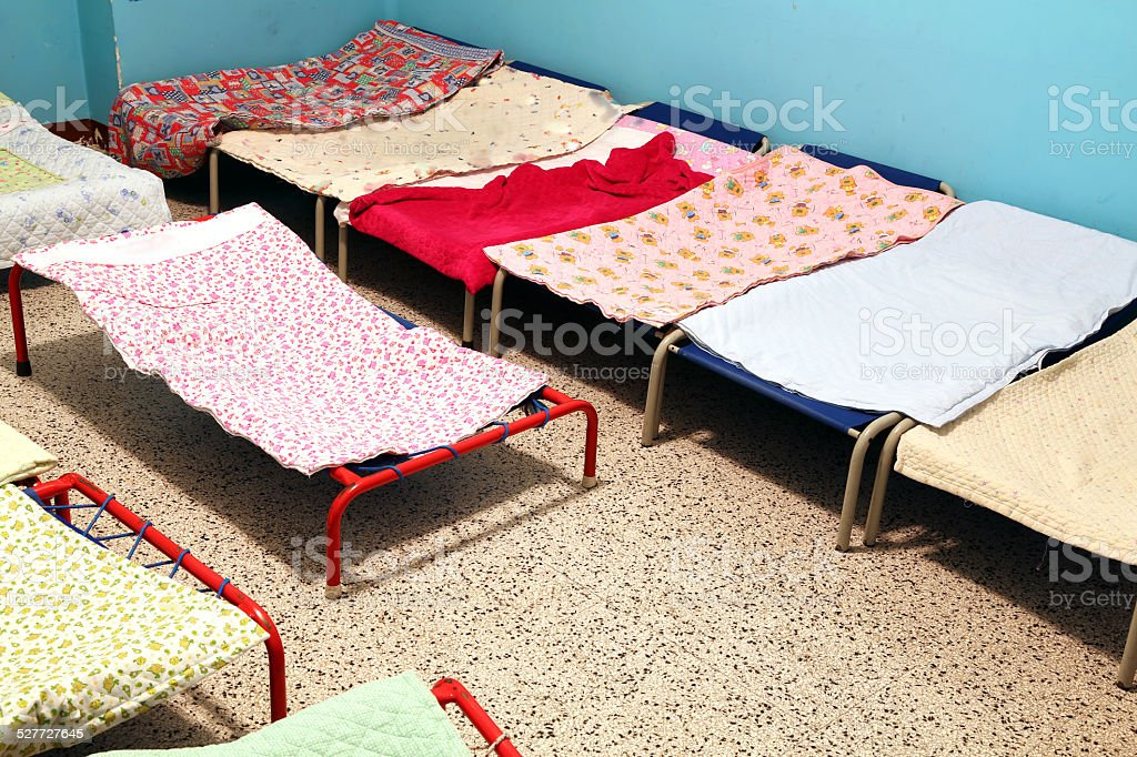 dormitory with small beds to sleep nursery children stock photo