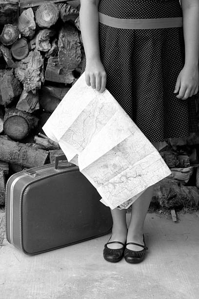 dorothy holding a map in b/w stock photo