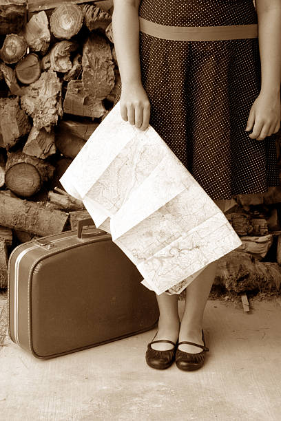 dorothy holding a map in sepia stock photo