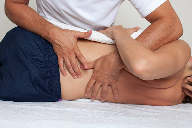 dorsal manipulation - osteopathy stock pictures, royalty-free photos & images