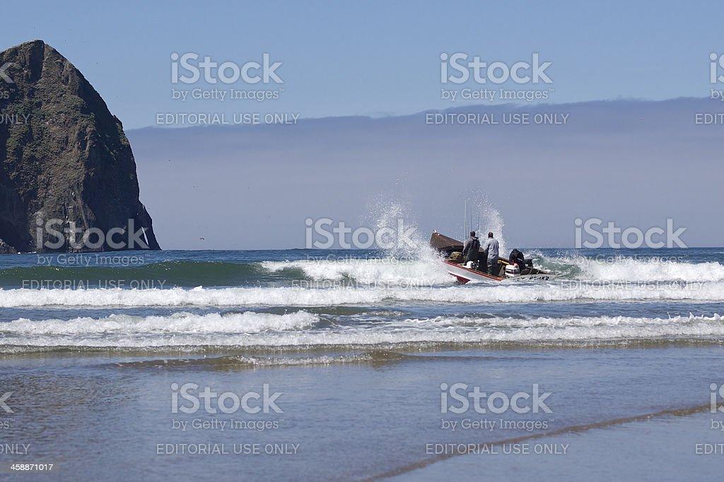 Dory Boat Launching in Waves Cape Kiwanda Pacific City Oregon royalty-free stock photo