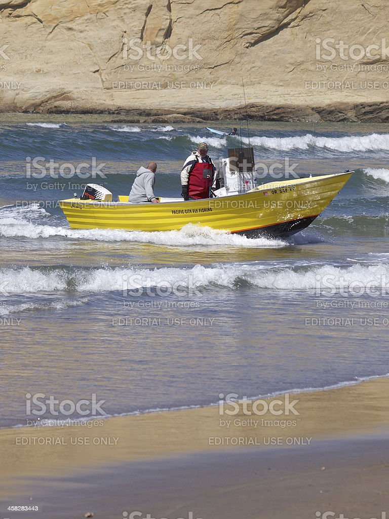 Dory Boat Returning in Surf Cape Kiwanda Pacific City Oregon royalty-free stock photo
